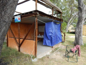 Our outdoor laboratory. We were fortunate to be able to work in this shelter. We added the blue tarp to hold back the wind.